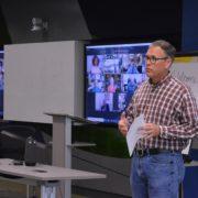 Greg Littleton directs board meeting